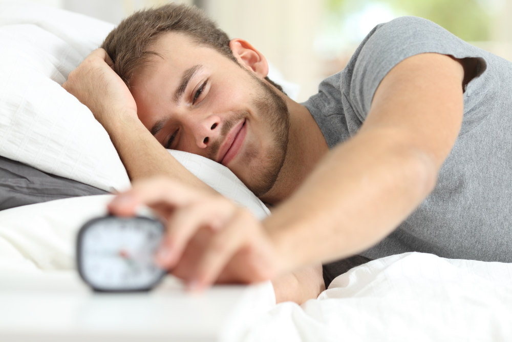 Happy wake up of a happy man lying on the bed and stopping alarm clock   Things In Life To Be Thankful For Every Day   things to be thankful for   list of things to be thankful for