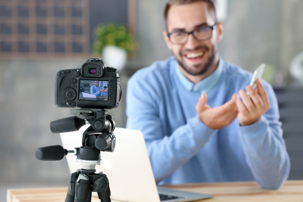 Young blogger recording video at home | How To Achieve Financial Stability By Next Year | financial stability is when you