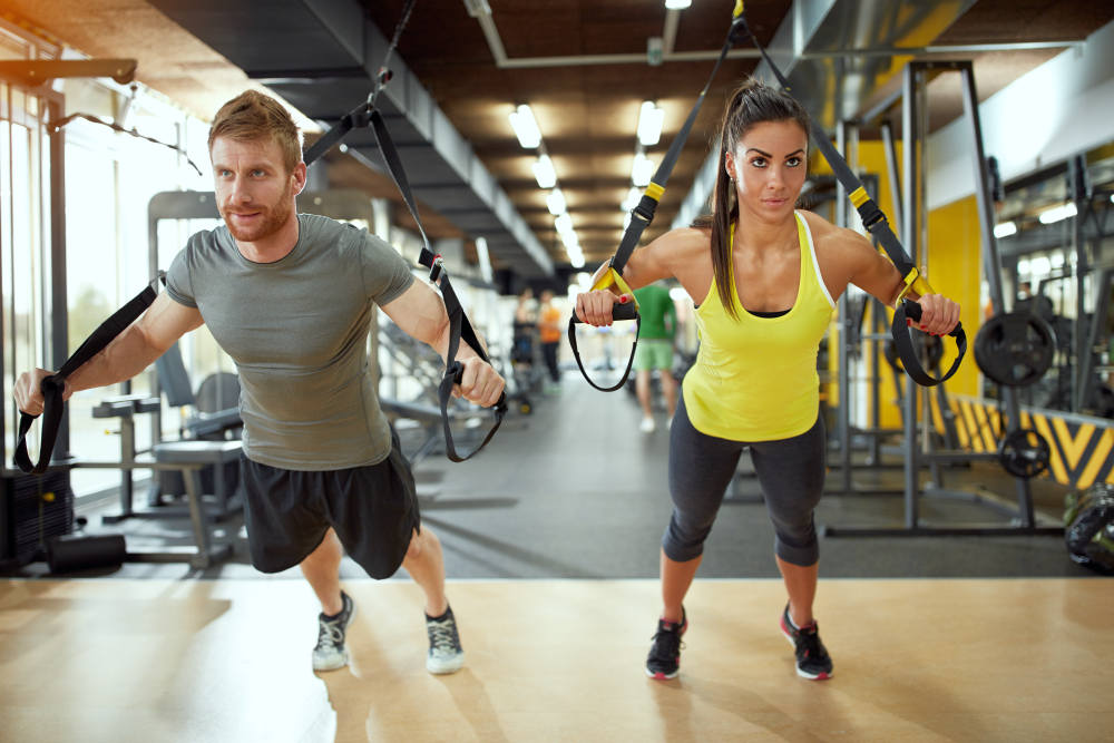 Young couple on body training in gym | The Quickest & Easiest Self-improvement Tips To Follow In The New Year | improving self