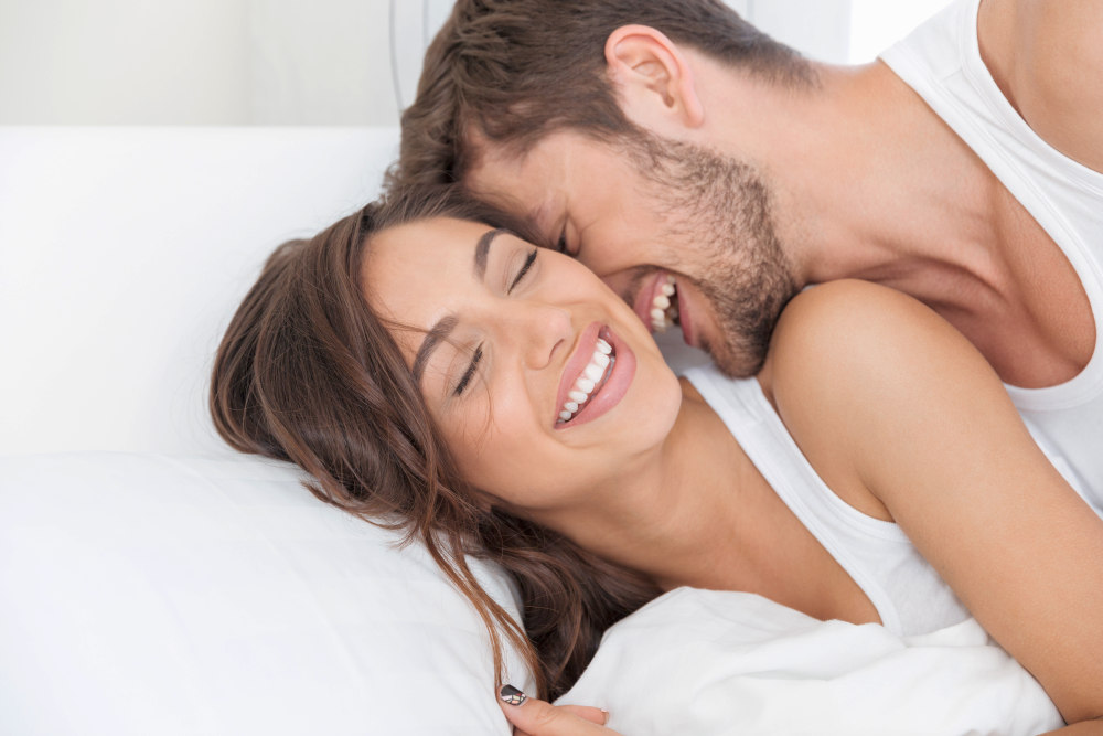 Young happy couple lying together in bed | How To Be Better In Bed For Romantic Love-Making | Romantic Love Making | romantic sexual ideas