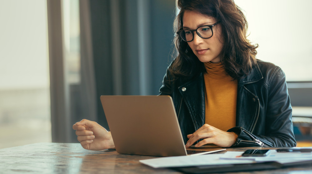 Business woman busy working on laptop computer at office | How To Be Self-Disciplined? 9 Powerful Tips To Be Positively Focused | developing self discipline | Featured