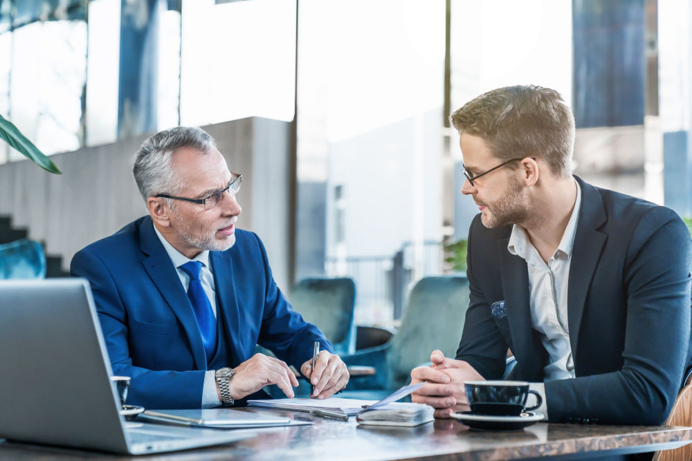 Young executive showing his business proposal | How To Be Self-Disciplined? 9 Powerful Tips To Be Positively Focused | how to discipline yourself