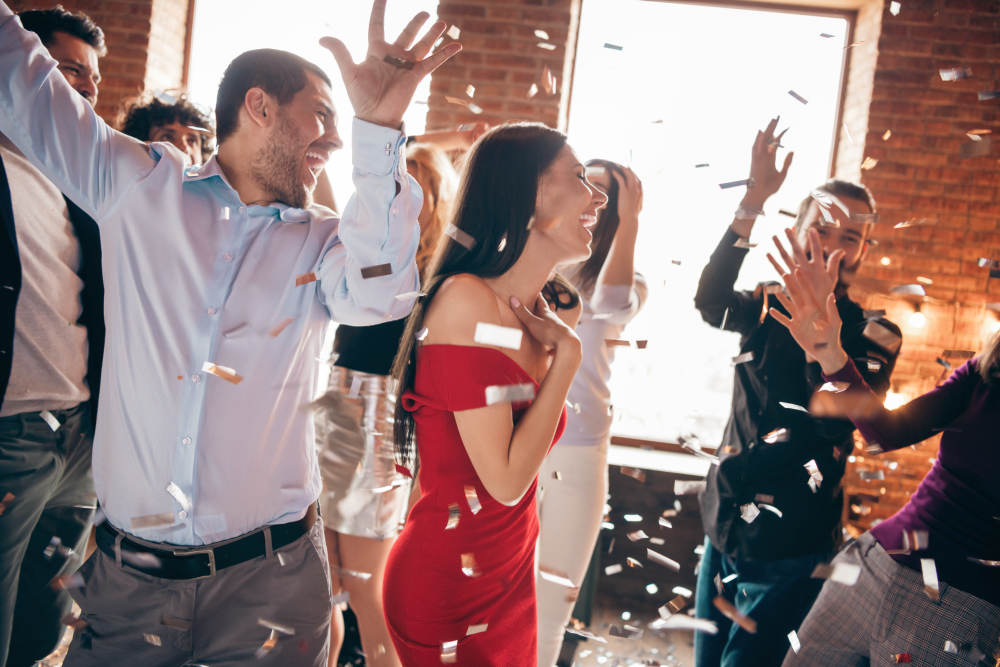 Photo of group friends on dance floor spending x-mas party together   How To Beat The Holiday Blues And Avoid Christmas Depression   depression on christmas