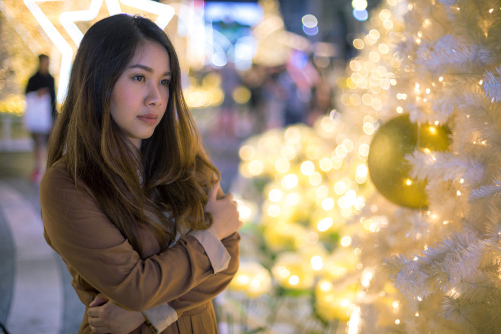 Lonely asian woman, outdoor in night   How To Beat The Holiday Blues And Avoid Christmas Depression   depression at christmas