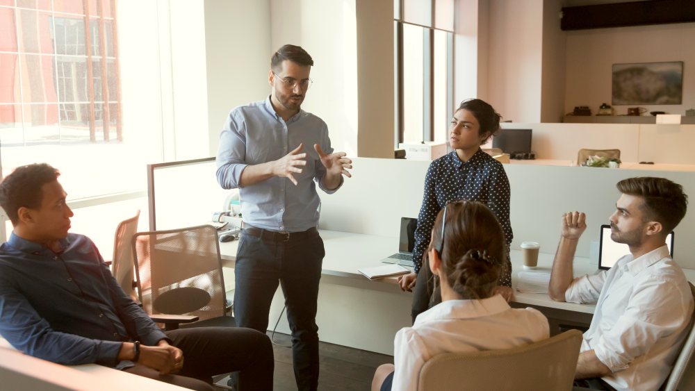 Multiethnic staff listen to boss instruct interns at briefing | Tips To Nurture The Entrepreneurial Spirit Within You | qualities of an entrepreneur