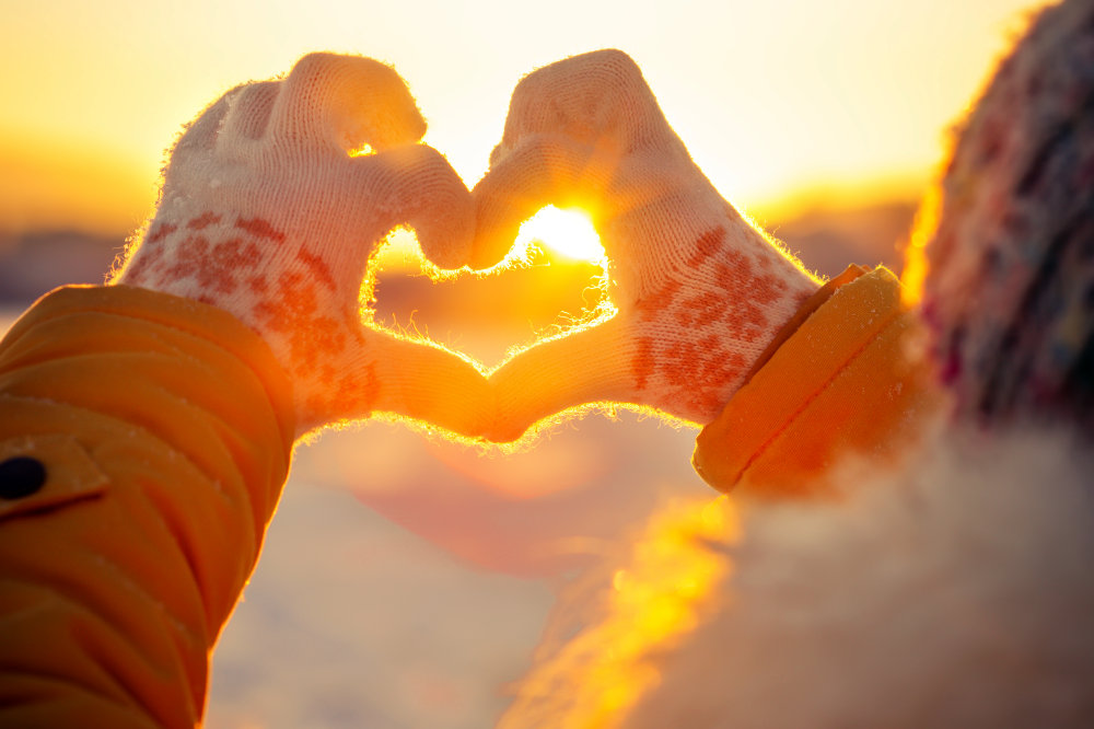 Woman hands in winter gloves Heart symbol shaped   How To Beat The Holiday Blues And Avoid Christmas Depression   after christmas blues