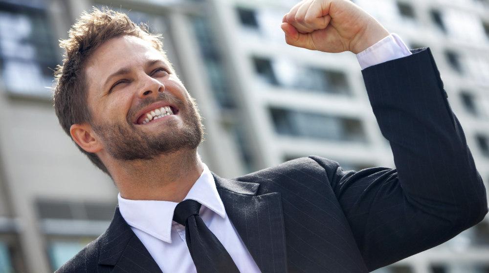 Male executive businessman arms raised celebrating | Top Entrepreneur Motivational Videos To Boost Your Success | Motivated entrepreneur | Featured