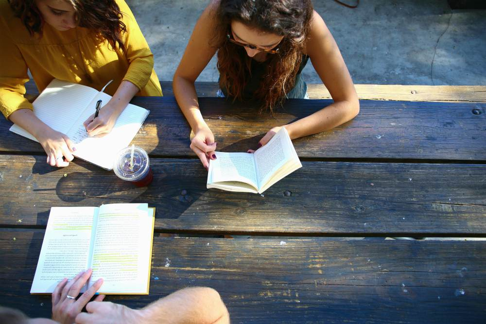 students studying together outdoor | How To Be A Better Friend: Simple Ways | how to be a better long distance friend
