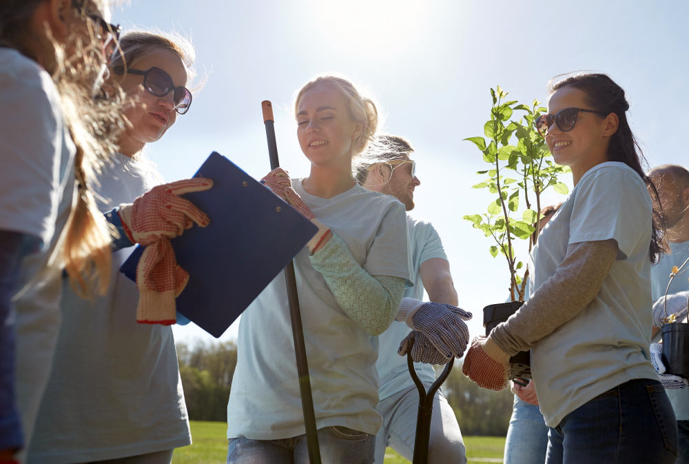 Happy volunteers with tree seedlings and clipboard in park | How Being Kind-Hearted Makes People Healthier | be kind quotes | kind hearted