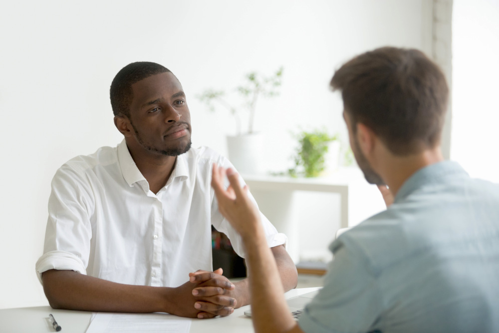 African American listening attentively to caucasian   How To Be A Better Wife: Practical Tips   how to be a better mom and wife