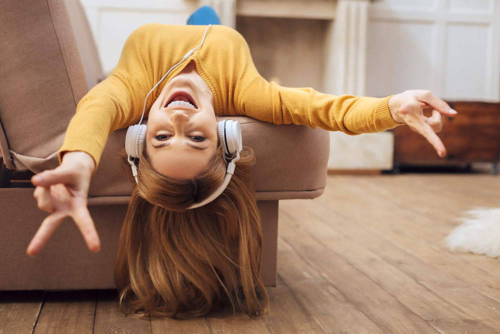 Pretty overjoyed young blond woman laughing and listening to music   Overcoming Depression: Simple Ways To Feel Better   overcoming major depression