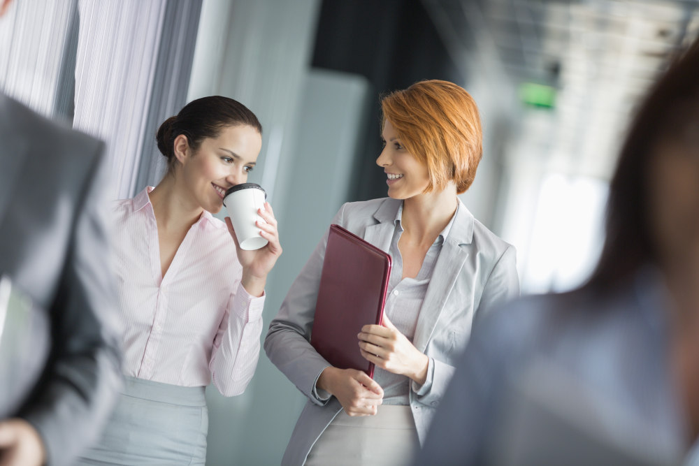 Businesswomen walking in office corridor | How To Stop Overthinking: Easiest Ways | how to stop overthinking and relax