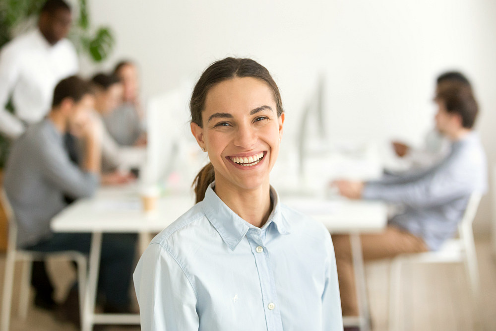Cheerful happy millennial girl intern laughing   Simple Ways To Become An Optimistic Person in 2020   definition optimistic person