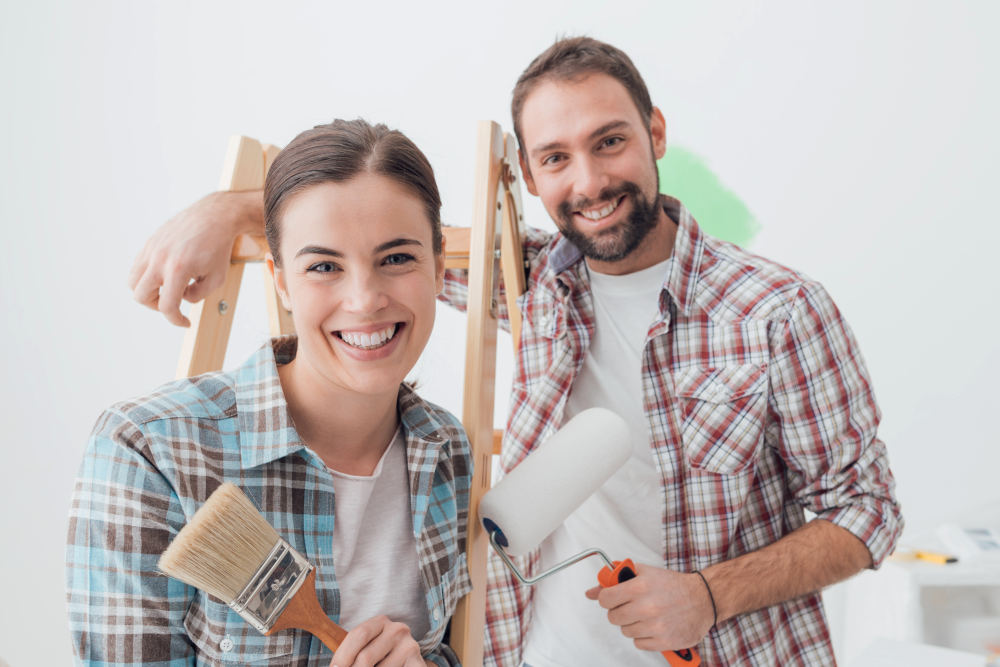 Creative young couple renovating their house and painting walls | Simple Home Improvement Ideas To Make Your Home More Vibrant | home improvement ideas diy