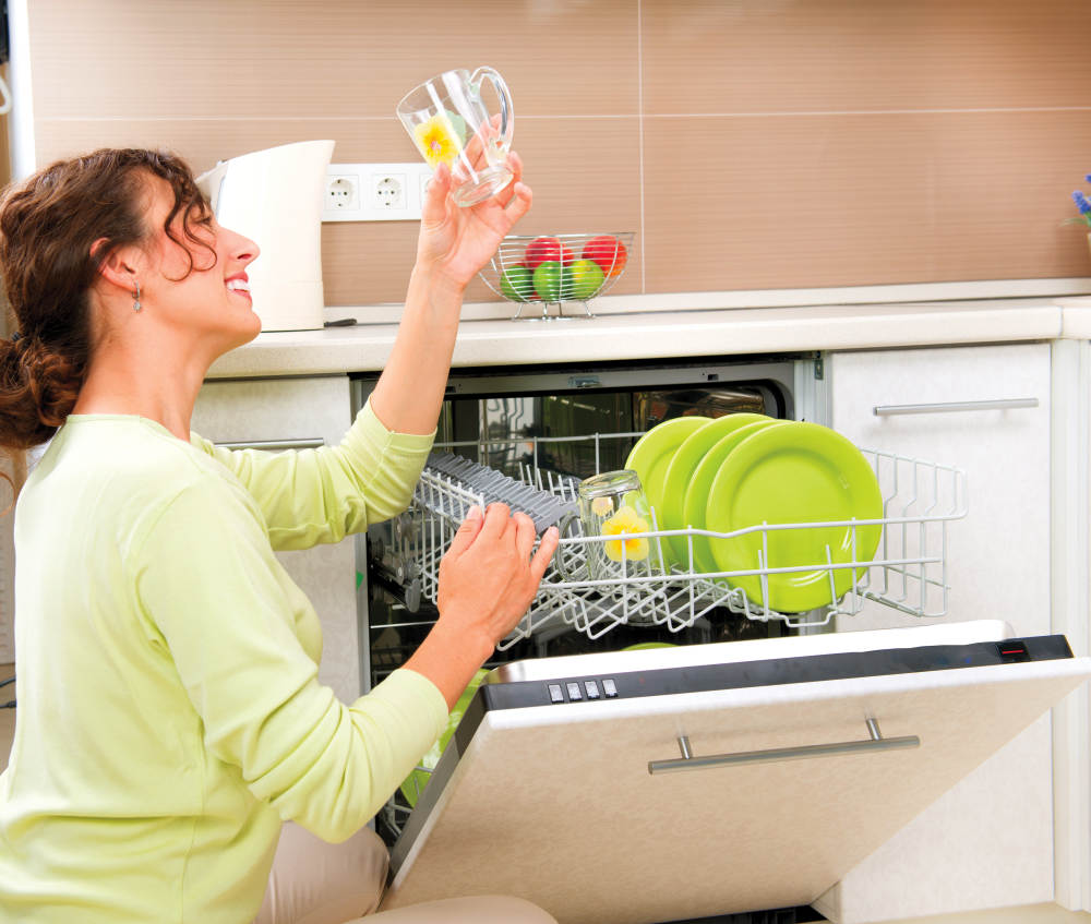 Happy Young woman in the Kitchen using dishwasher machine | Simple Home Improvement Ideas To Make Your Home More Vibrant | diy home improvement ideas