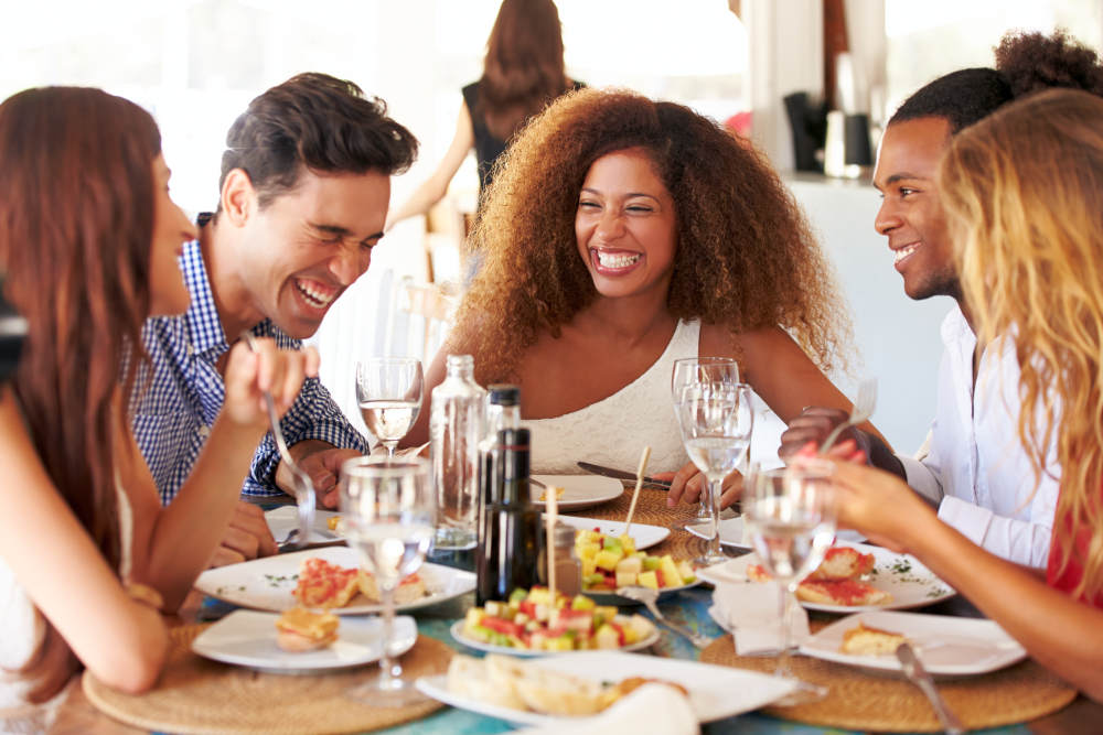 Group Of Young Friends Enjoying Meal In Outdoor Restaurant   Overcoming Depression: Simple Ways To Feel Better   overcoming existential depression