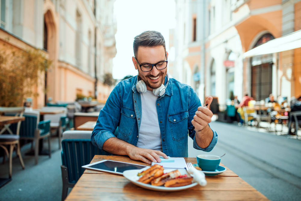 Handsome modern freelancer having breakfast at cafe | Morning Motivation Hacks To Start The Day Right | monday morning motivation