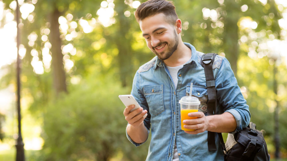 Happy hipster man walking in autumn park and smiling | How To Survive Quarter Life Crisis In Your 20s | quarter-life crisis | Featured