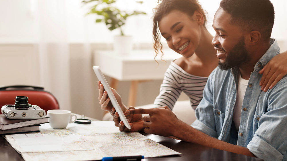 Couple using tablet, searching places to visit   How To Be A Better Wife: Practical Tips   how to be a good wife tips