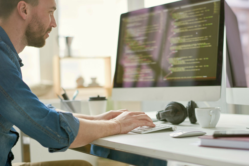 Serious pensive experienced male programmer typing code on computer | Business Ideas That Can Be Worth Millions Of Dollars | business proposal ideas | business proposal
