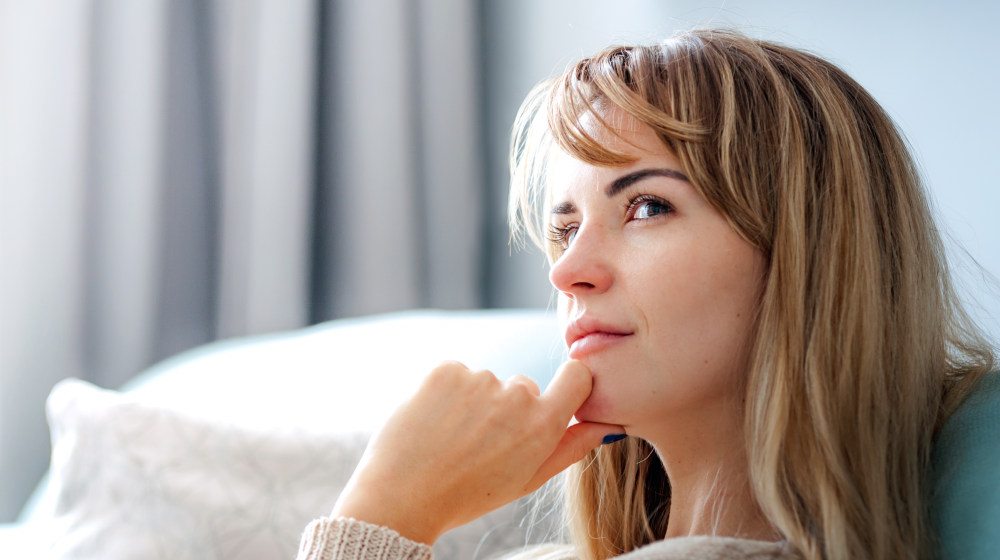 Woman at home deep in thoughts thinking and planning | How To Overcome Things That Leave Us Feeling Defeated | feeling defeated at work | Featured