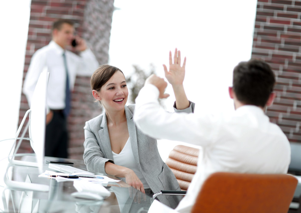 Business colleagues enjoying our success | Motivational Sales Quotes That Will Fire Up Your Team | sales motivation | sales motivation stories