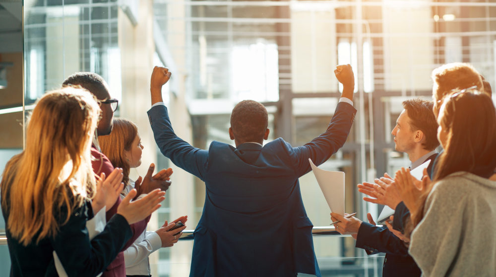 Business team celebrating a triumph with arms up | Inspiring Movies That Can Change Your Life | most inspiring movies of all time | Featured