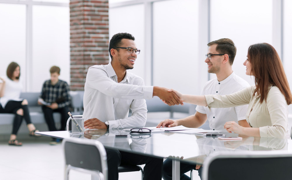 Handshake of business people in the lobby | Motivational Sales Quotes That Will Fire Up Your Team | sales motivation | sales motivation quotes