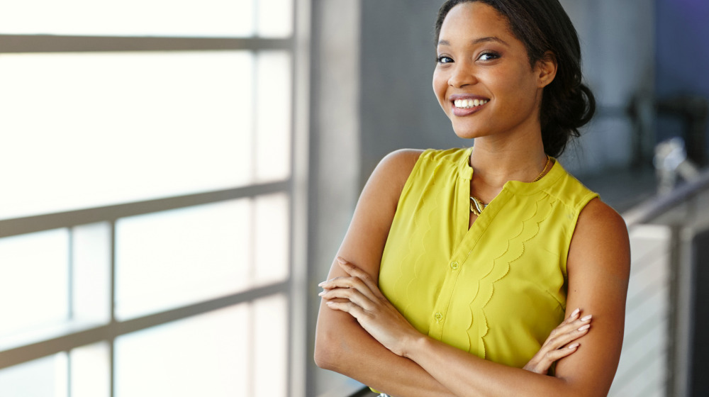 Confident black businesswoman at work in her glass office | Practical Ways To Build Your Self-Worth in 2020 | self worth | self worth quotes | Featured
