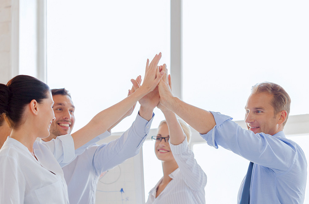 Happy business team giving high five in office | Inspiring Movies That Can Change Your Life | best life changing movies