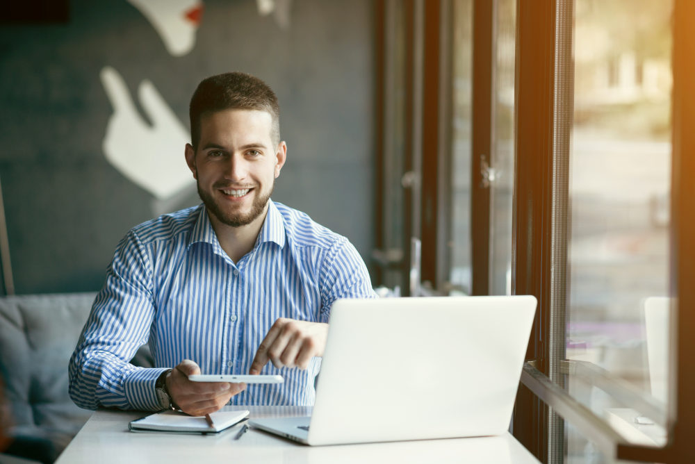 Young man drawing template for the web site associated with digital marketing | Corporate Development Tips from Famous Professionals | business development