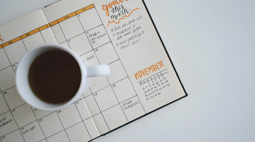 A cup of coffee on schedule note | Keeping A Schedule