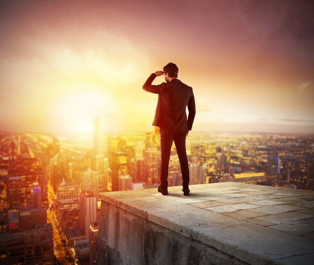 Successful man standing at the peak | Opportunistic