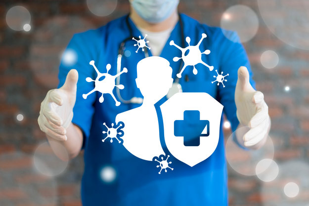 A male doctor with gloves and masks holding icons of immune system | Strengthen Immure System
