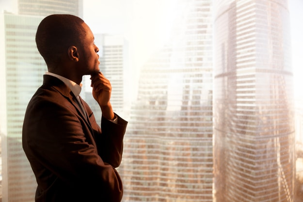 A thinking man looking out the window | Holding Out