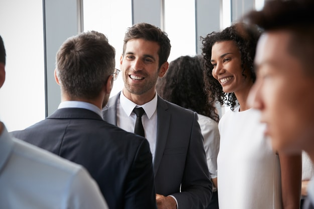 Successful business men talking and smiling | In-Person Networking