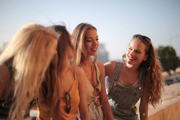 A group of young beatiful women chatting and smiling | Smile