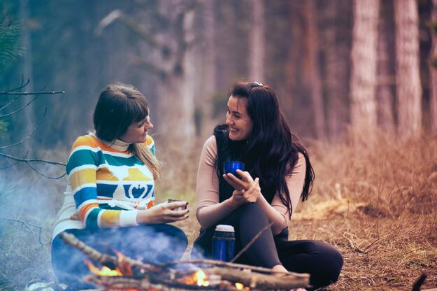 2 happy women talking while camping in a forest | Understand That Just Being There For Someone is Enough