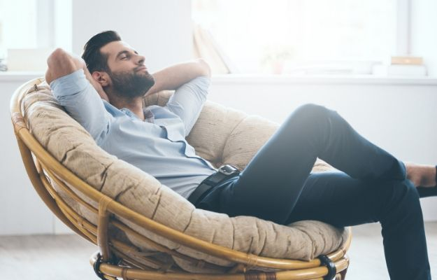 a man relaxing on the couch | Let go