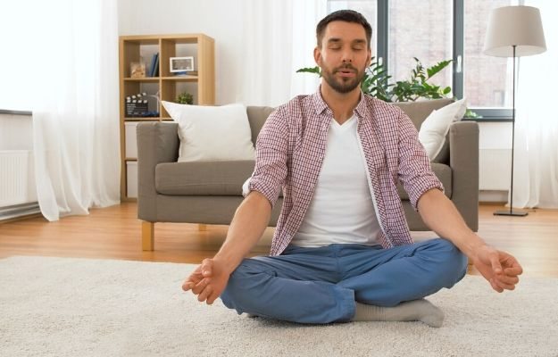 a man taking deep breath while doing meditation | mindful breathing