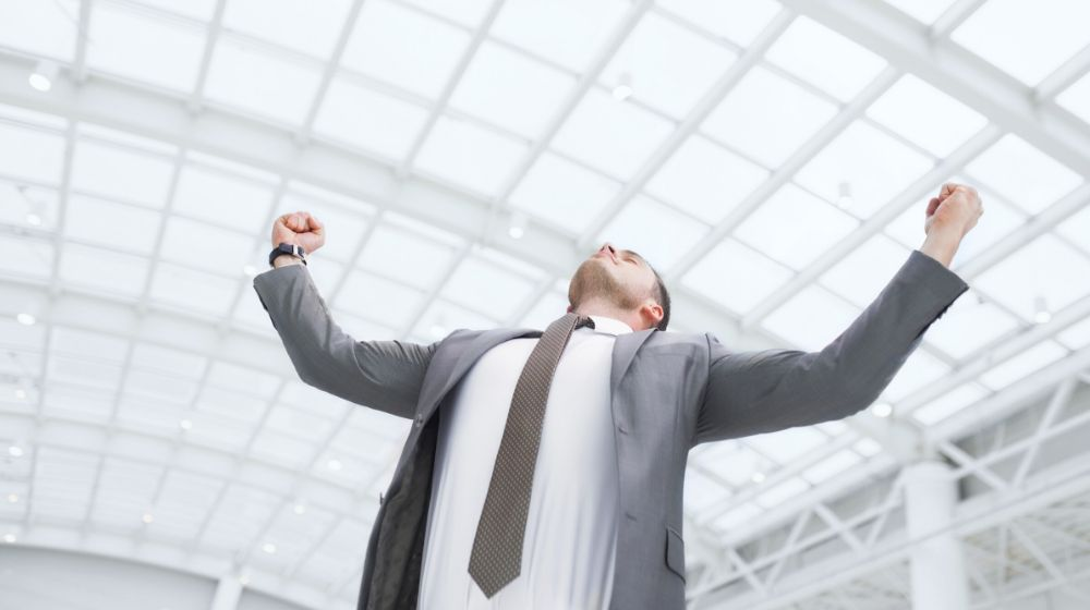 a successful business man feeling encouraging | feature | 11 Tips From Successful and Famous Business People