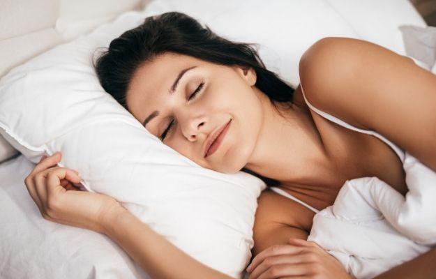 a woman sleeping well on the bed | sleeping better