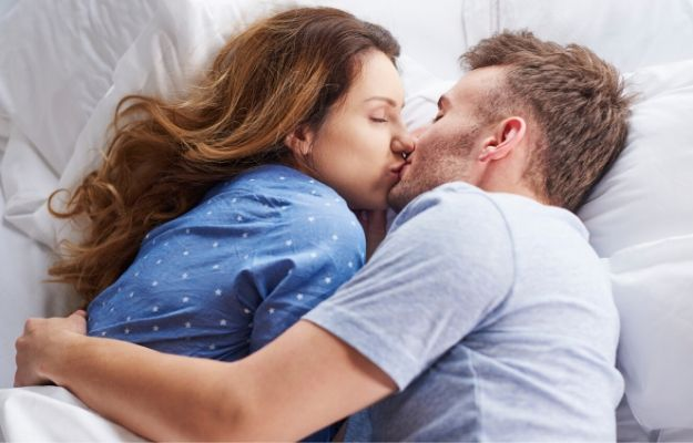 two people holding and kissing in bed | kiss in a safe place