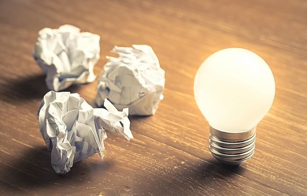Learn From Mistake, glowing light bulb and crumbled paper balls | Learn from failure