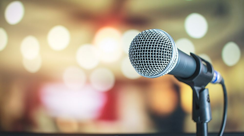 Microphone on abstract blurred of speech in seminar room | Feature img | Famous Sayings And Where They Came From