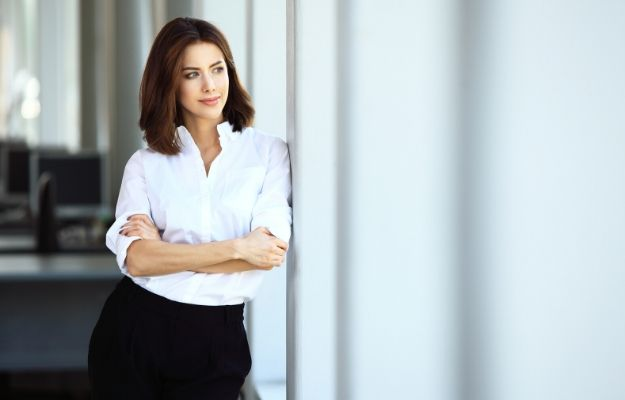 Modern business woman in the office with copy space | Believe In Yourself​ | How To Assert Yourself: 9 Tips To Be More Assertive