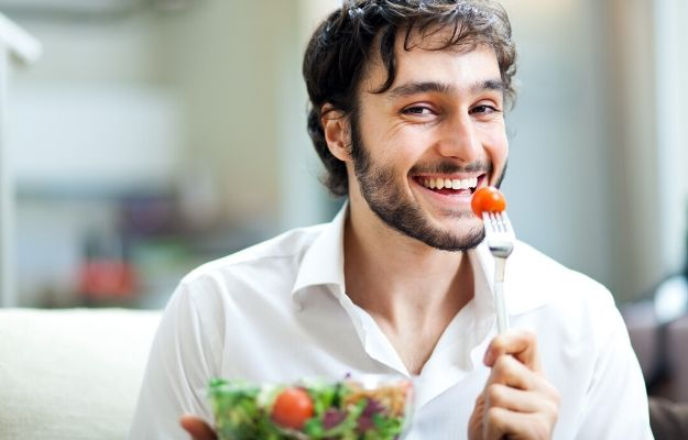 Young man eating a healthy salad | Stay Healthy | How To Respect Yourself (10 Ways)