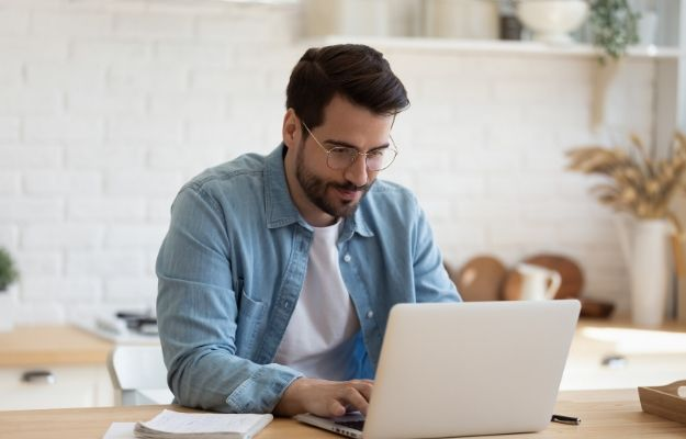 a man researching on laptop | Oops! Looks like that's not going to work. Try refeshing the page, or click here to return home. | How To Ace A Job Interview (And GET The Interview)
