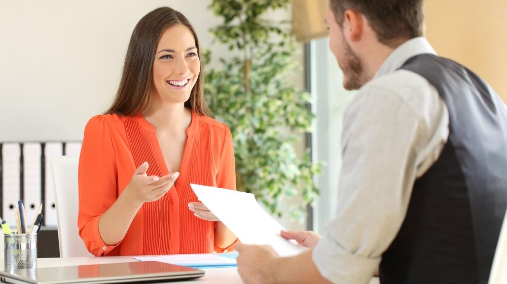 a woman having an interview with a male manager | feature | How To Ace A Job Interview (And GET The Interview)