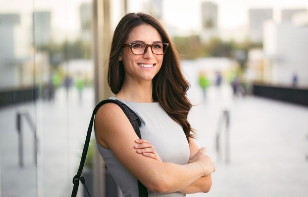 business woman folding her arms and smiling | Dont be afraid | Dont be afraid | How To Be More Present And Live In The Now